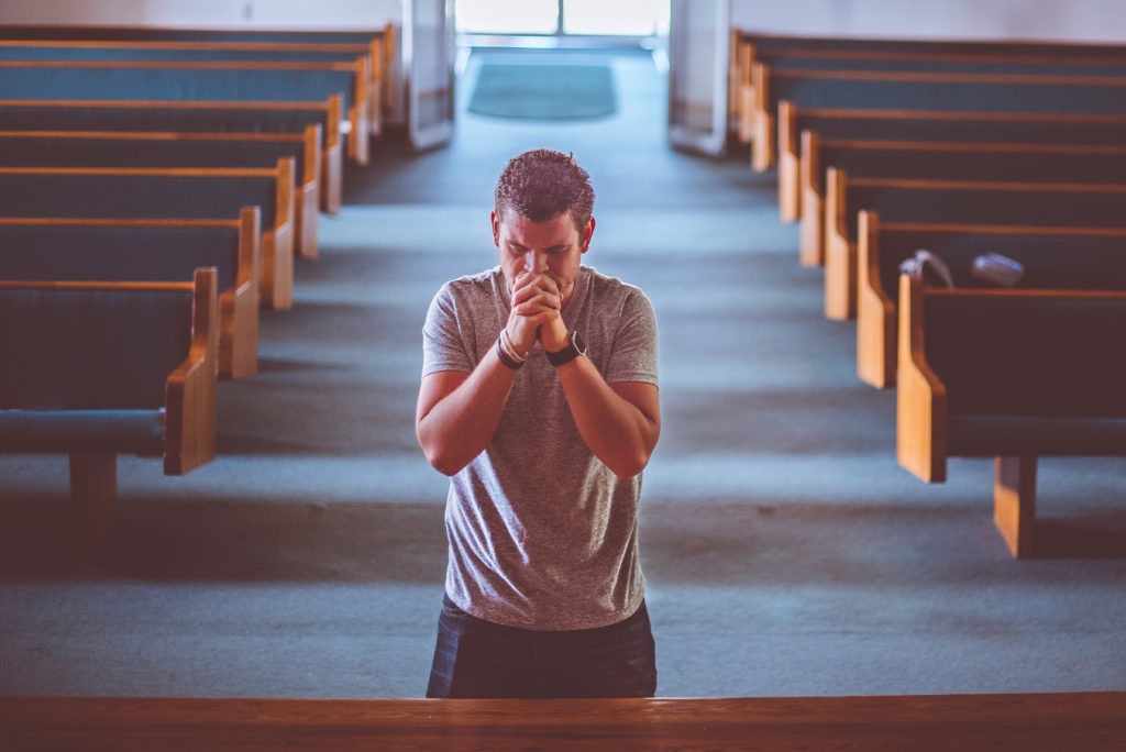 man kneeling to pray